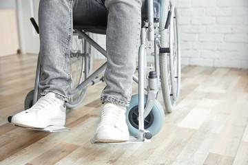 Man in wheelchair indoors, closeup