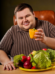 Diet fat man eating healthy food. Healthy breakfast with vegetables cauliflower. Male trying to lose weight. Overweight person was on diet for long time. How to choose best vegetables.