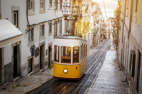 The Gloria Funicular in the city center of Lisbon in a beautiful summer day, Portugal