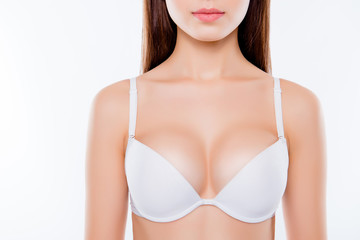 Cropped close up photo of sexy woman's breast wearing white classic elegant brassiere she has clean clear sensual fresh  pure skin, skinny slim slender body isolated on background