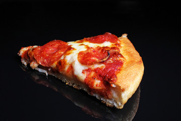 Pizza. Pizza slice on black reflective studio background. Isolated black shiny mirror mirrored background for every concept.