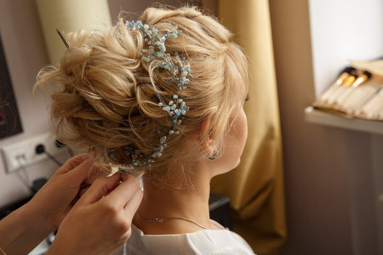Wedding hairstyle and makeup. Makeup artist made makeup for beautiful bride at wedding day
