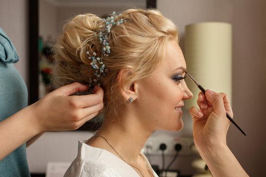 Bride with smoky eyes. Wedding makeup. Makeup artist made makeup for beautiful bride at wedding day