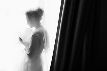 Silhouette of bride. Black and white wedding photo
