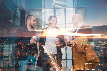 Double exposure concept with business people and city