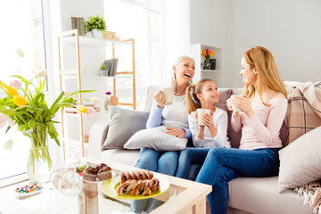 Parenthood motherhood leisure comfort retirement people generation joy friendship concept. Excited sweet lovely adorable carefree restless laughing joking relatives sitting on divan spending time