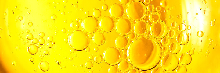 Yellow oil bubble on water.