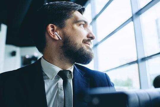 man with wireless earpiece