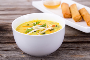 delicious thai curry coconut chiken soup bowl