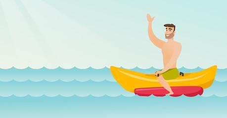 Young happy caucasian white man riding a banana boat and waving hand. Cheerful man having fun on a banana boat in the sea. Man enjoying summer vacation. Vector cartoon illustration. Horizontal layout.