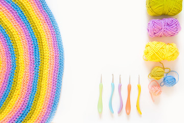 Color striped crocheted crochets. White background.