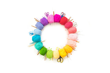 A circle of a wreath of colored yarn for knitting. White background.