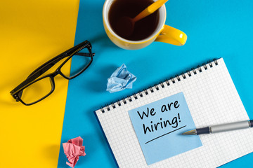 WE'RE HIRING CONCEPT at Human Resources Manager workplace. Job recruiting advertisement