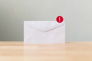 Email concept, Envelope with symbol notification on wood table