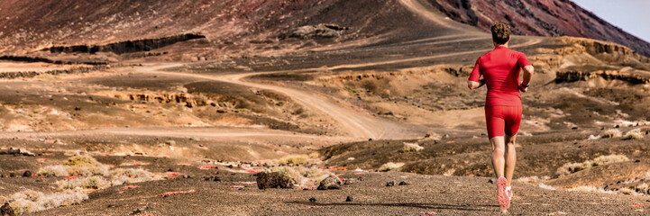 Athlete runnin on trail path, sports and fitness active lifestyle. Man runner on long distance run through desert summer landscape. Banner panorama crop of mountain background.