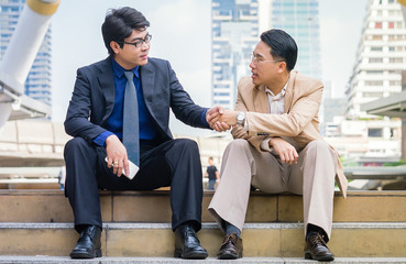 Image of two businessman Handshaking,happy with work,they are enjoying  workmate,Handshake Gesturing People Connection Deal Concept