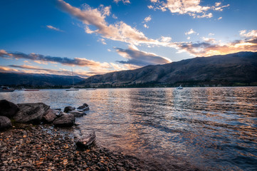 Sunset at Wanaka lake-front from Eely Point. Wanaka is a popular ski and summer resort town in the Southern Island of New Zealand.