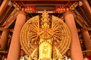 Chinese mythology At Guan Yin Temple And Buddhist statues in Bangkok, Thailand.Chinese pagodas temple and god statue.Golden Wood Statue of Guan Yin with 1000 hands.