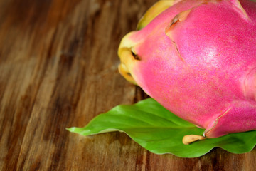 Pitaya or dragon fruit on a wooden background