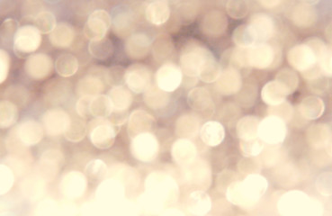 Beautiful blurry golden background, festive bokeh light