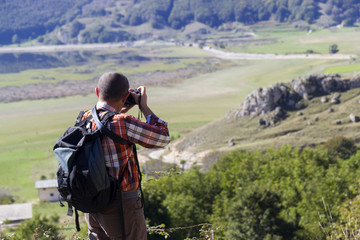 hiker take photo on mountain peak