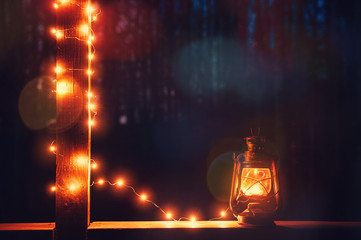Vintage retro lantern with bokeh lights over dark background