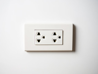 White socket 220 volts on white wall, unplugged