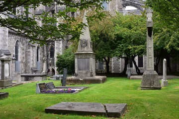 Old cemetery on grounds of stone gothic cathedral in Dublin in Ireland.