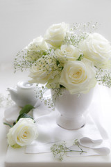 Vase of white Roses with tea