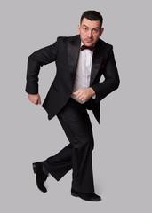 funny elegant man in black tuxedo