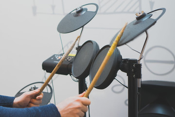Man playing on electronic drums.