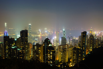Landscape of Hong Kong and Kowloon in night time with mist, Hong Kong, China, Asia.