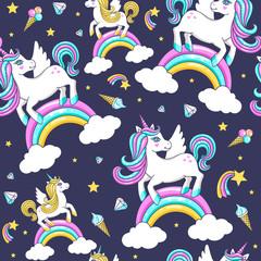 Seamless pattern with cute unicorns. Vector illustration.