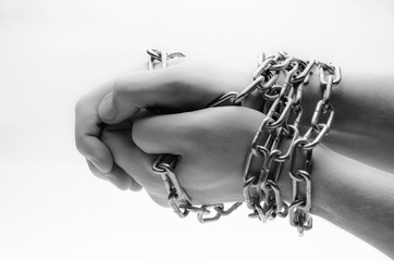 Hands are chained in chains isolated on white background