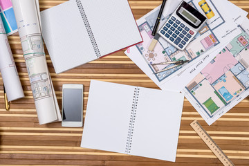 concept of architecture drawing - house, notepad, pen, ruler, compass, calculator