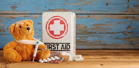 Cute little teddy bear receiving First Aid