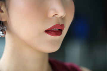Beautiful model girl with lipstick ,Red woman lips close up,beauty concept.