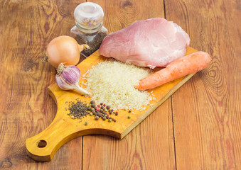 Ingredients for cooking pilaf on a rustic table