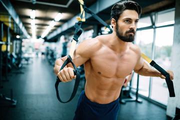 Caucasian man exercising suspension training trx