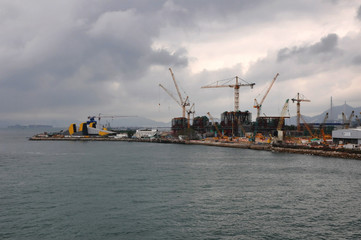 Construction Site of a new area of Hong Kong harbor with many cranes