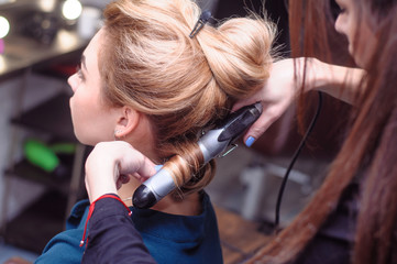 Locks in the hairdresser. Professional hair styling in the salon