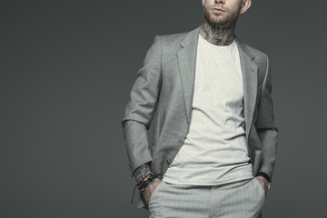 cropped view of stylish businessman in grey suit, isolated on grey