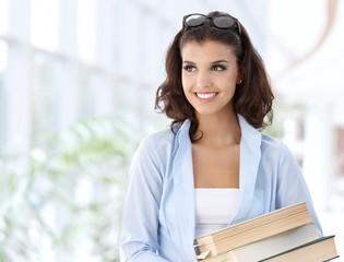 Happy female student on school corridor