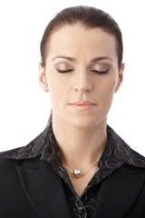 Businesswoman concentrating with eyes closed