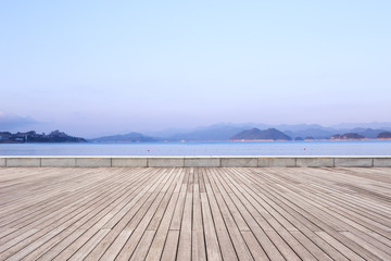 empty wooden floor with beautiful lake