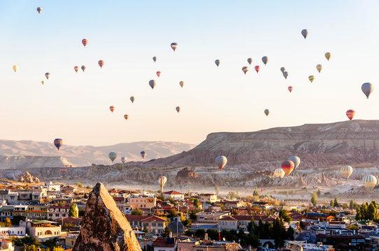 Hot air balloon flying over valleys in Cappadocia Turkey