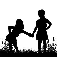 silhouette of little girls playing on grass
