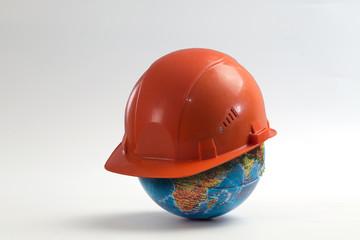 Construction helmet on the globe