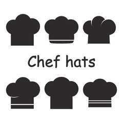 Set of chef hats, black and white silhouette. Vector illustration