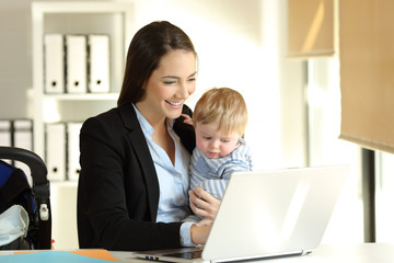 Mom working with her baby son at office